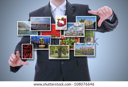 business hand holding a touch pad computer and 3d streaming images - stock photo