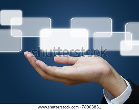 Business hand holding a touch screen interface - stock photo