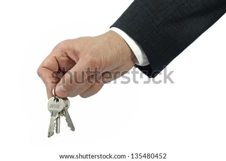 business hand holding keys - stock photo