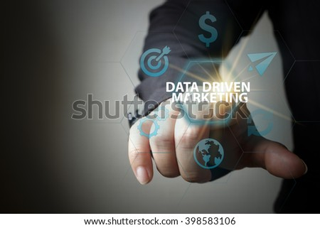 business hand pressing  interface and select DATA DRIVEN MARKETING button , business concept