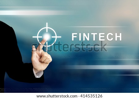 business hand pushing fintech or financial technology button on a touch screen interface - stock photo