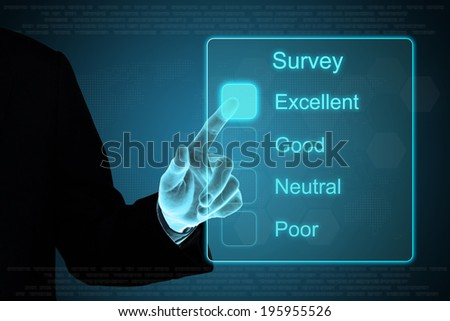business hand pushing survey on a touch screen interface  - stock photo