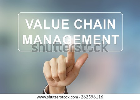 business hand pushing value chain management button on blurred background - stock photo