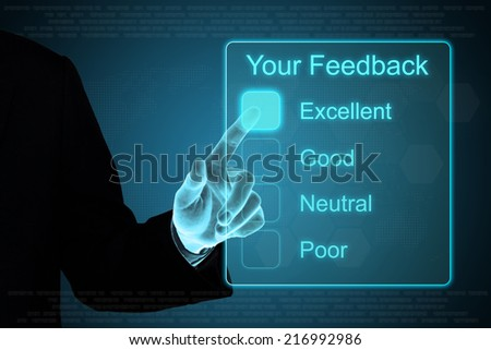 business hand pushing your feedback on a touch screen interface  - stock photo