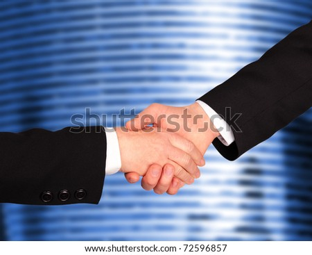 Business Hand shaking with modern building background - stock photo