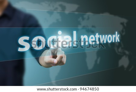 Business hand touch social network - stock photo