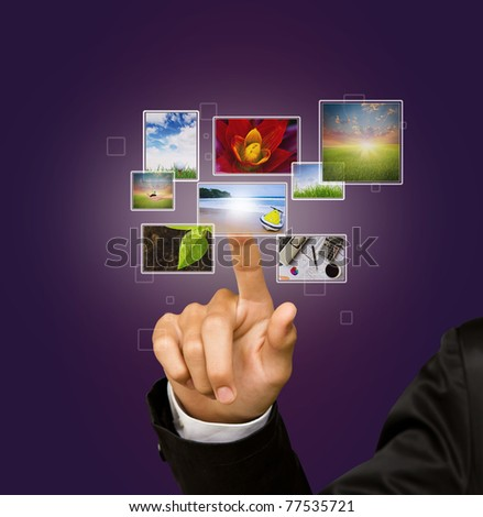 Business Hand touches the flow of images - stock photo