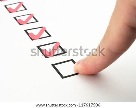 business hand with pen marking check boxes - stock photo