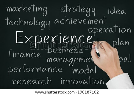 business hand writing experience concept on chalkboard - stock photo