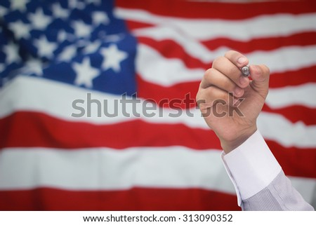 business hand writing over blurred crumpled retro american flag with vignette backgrounds.american memorial concept.business concept.