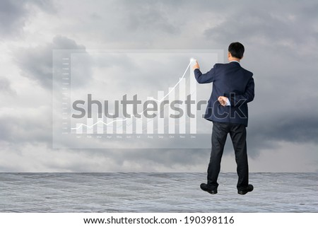 business hand writing revenue and cost  - stock photo
