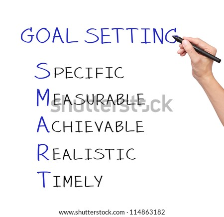 business hand writing smart goal or objective setting - specific - measurable - achievable realistic - timely - stock photo