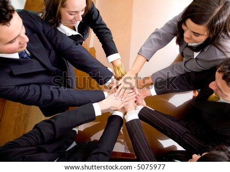 business hands of teamwork in an office in a meeting room - stock photo