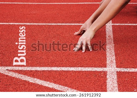 business - hands on starting line - stock photo