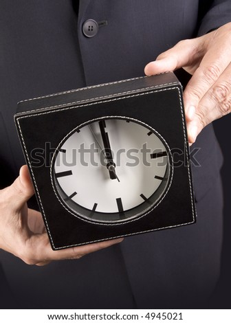 Business hands with clock with clipping path. - stock photo
