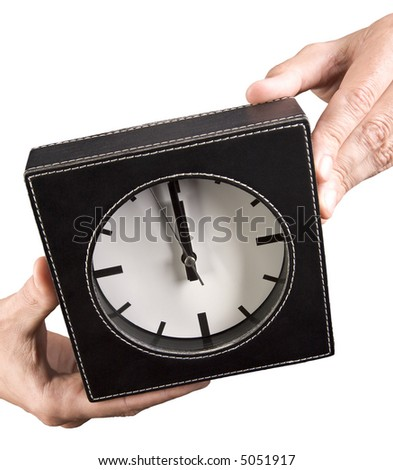 Business hands with clock with clipping path.