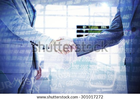 Business handshake against stocks and shares - stock photo