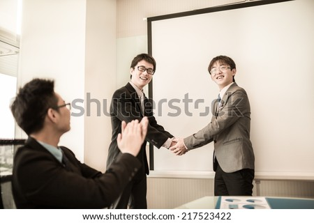 Business handshake and business people.Asian - stock photo