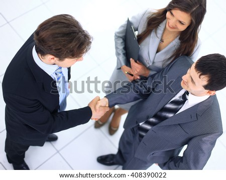 Business handshake and trust taken from above