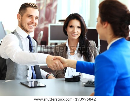 Business handshake. Business people shaking hands, finishing up a meeting  - stock photo