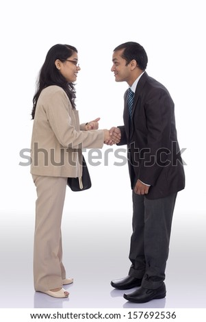 Business handshake by Indian business people. - stock photo
