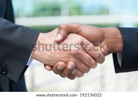 Business handshake. Close-up of business men shaking hands - stock photo