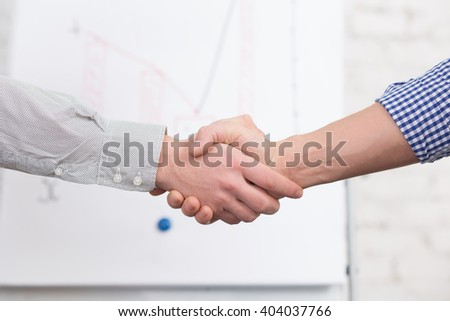 Business handshake concept. Business people agreed to sign contract or agreement in office. Two men are colleagues now. - stock photo
