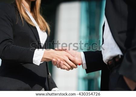 Business handshake - corporate man and woman - stock photo