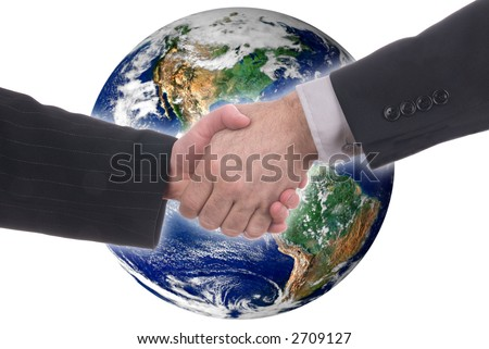 business handshake in front of a globe of the western world isolated on a white background - stock photo
