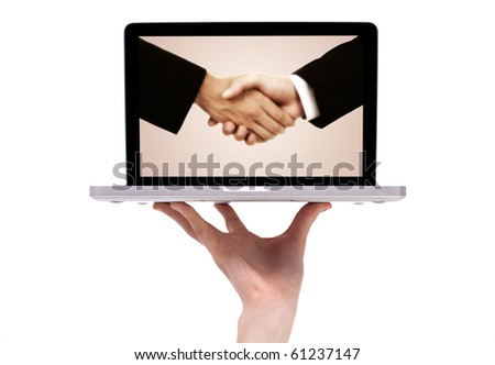 business handshake in modern laptop, isolated on white - stock photo