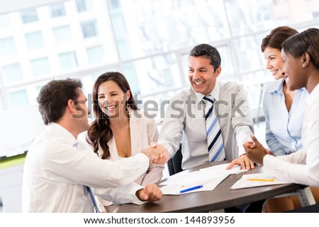 Business handshake in the middle of a meeting at the office - stock photo