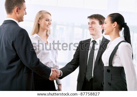 Business handshake of two successful partners in modern office