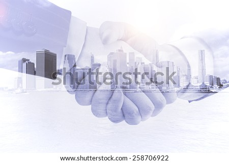 business handshake on a city background, double exposure - stock photo