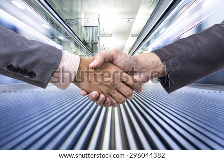Business handshake on business movement background - stock photo