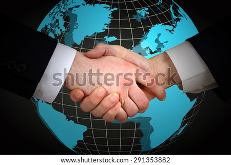 Business handshake on world map background