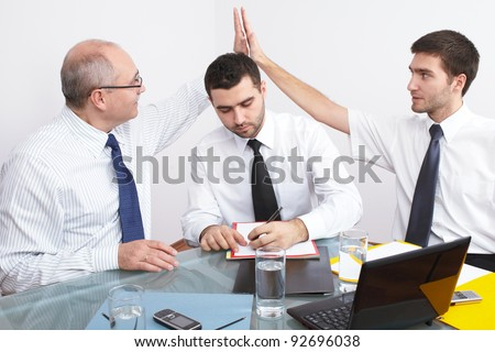 Business handshake over just signed contract or agreement. - stock photo