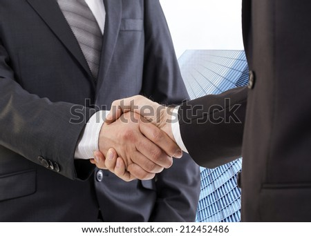 Business handshake, the deal Is finalized - stock photo