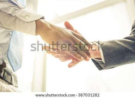Business handshake. Two businessmen reaching an agreement and making a deal. - stock photo
