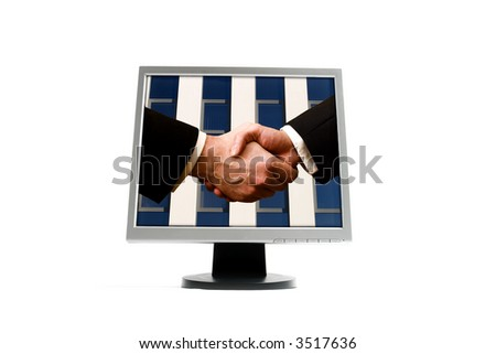 Business handshake with blue office building on screen - stock photo