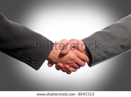 Business handshake with gray background