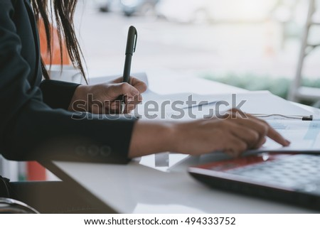 business home office desk background,hand holding pencil and writing note on wood table,Checklist Notice Remember Planning Concept