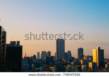 Business Ideas for Real Estate - City scape, Silhouette of building with sunlight in morning.