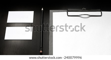Business identity template on the black wooden table (mock up for your design) - stock photo