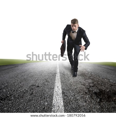 Business in action with running businessman in a road - stock photo
