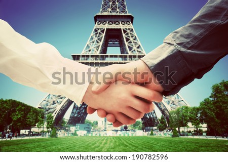 Business in Paris, France. Handshake on Eiffel Tower background. Deal, success, contract, cooperation concepts  - stock photo