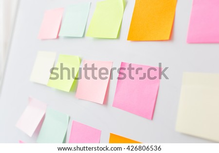 business, information, memo, management and education concept - close up of blank paper stickers on white board - stock photo