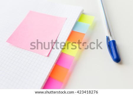 business, information, memo, management and education concept - close up of notebook or organizer with blank tags and sticker and pen on office table - stock photo