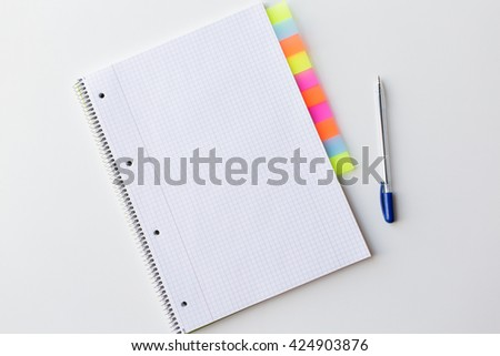 business, information, memo, management and education concept - close up of notebook or organizer with tags and pen on office table - stock photo