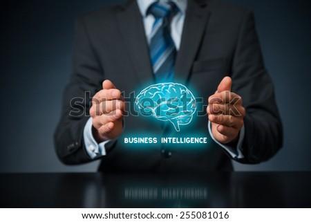 Business intelligence (BI) concept. Businessman with icon of brain and text business intelligence in protective gesture.  - stock photo
