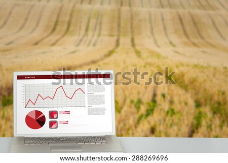 Business interface with graphs and data against rural fields - stock photo